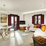 living room with sofa bed and dining table in luxury accommodation near alhambra granada
