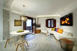 nice living room with corner sofa bed and balcony with alhambra views in albaicin granada