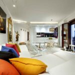 corner white leather sofa bed in open concept livingroon in new apartment for rent albayzin granada