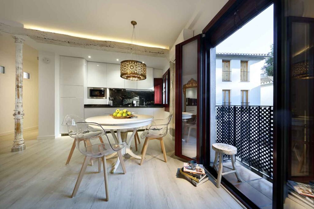 dining area in open concept kitchen with balcony overlooking alhambra; best airbnb near alhambra