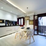 dinning table for four with full kitchen in luxury accommodation near alhambra Granada Spain