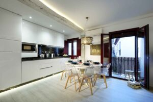 dining table set for six people in boutique short term apartment rental albaicin, granada spain