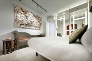 modern art in boutique bedroom in airbnb apartment, albaicin, granada, spain