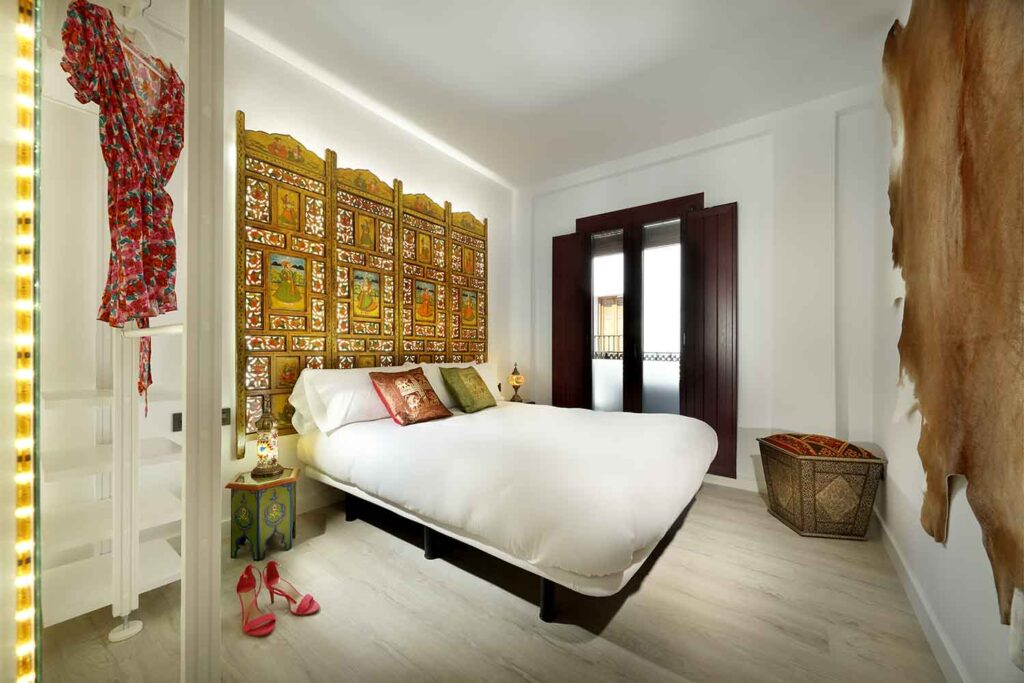 double bedroom with Indian headboard in fancy apartment for rent, albayzin, granada, spain