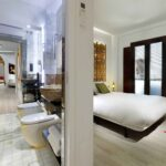 bedroom and bathroom of high end apartment near alhambra fortress, granada, spain