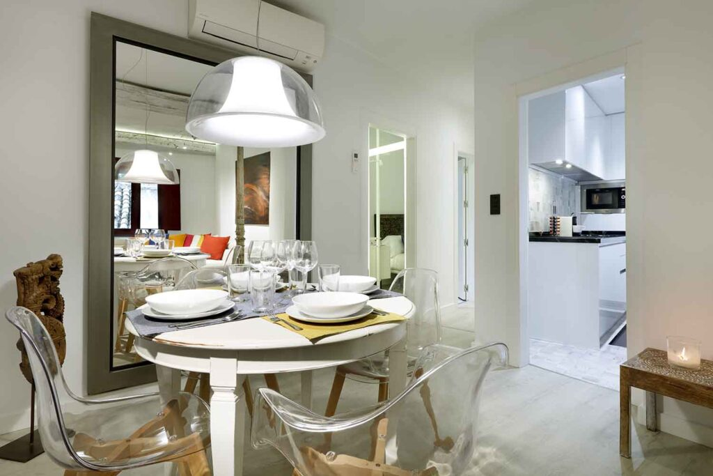 art chapiz modern apartment for rent with dining table set for four people in granada
