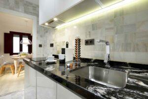 modern integrated kitchen in cozy short term apartment rental in the albaicin quarter, granada