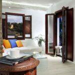 coffee set with alhambra views through the living room window in apartment rent art chapiz granada