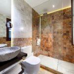 marble walled bathroom in airbnb in granada
