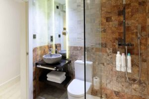 cozy bathroom with shower in boutique accommodation in the albaicin, near the alhambra