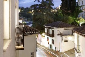 living room balcony overlooking the alhambra forest in short term rental accommodation, albaicin