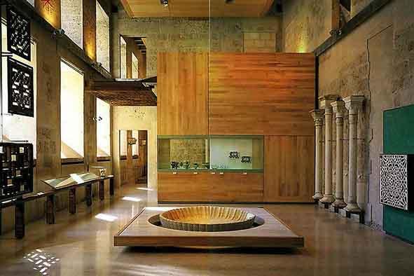 arab architecture details shown in alhambra museum room in granada