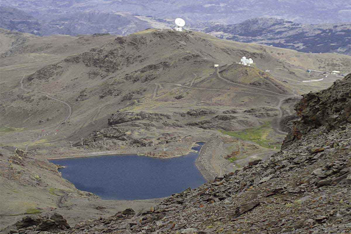 view from the top of Sierra Nevada over the astronomical observatory and granada in background