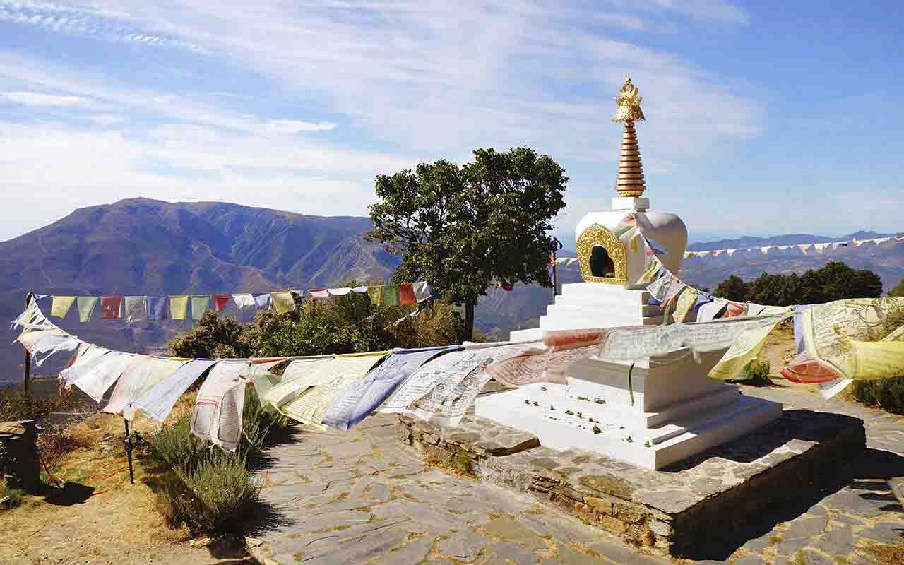 buddhist center in Alpujarras seen among mountains and against blue sky