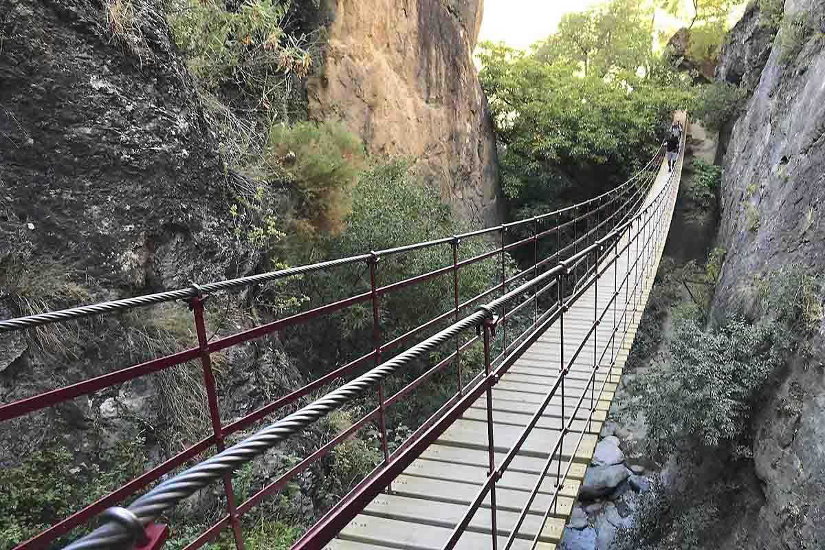 hanging bridge over Monachil river in los cahorros, part of Sierra Nevada natural park, spain