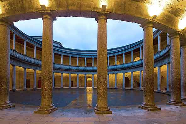 colonnade lit at sunset at Charles V palace in Alhambra spain