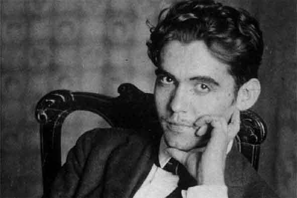 old black and white portrait of the spanish writer federico garcia lorca sitting on a chair