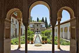 alhambra ticket Generalife gardens seen through muslim arches if you buy alhambra tickets last minute