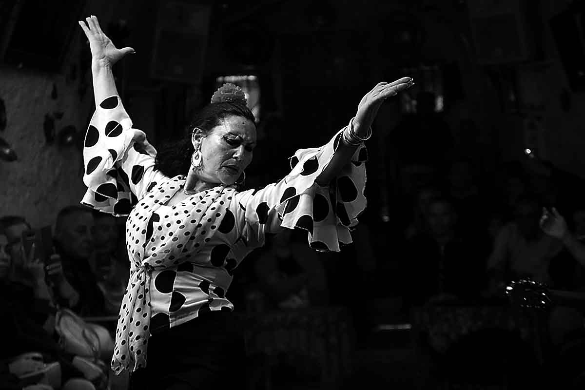 gypsy flamenco dances in a sacromonte cave, in granada spain