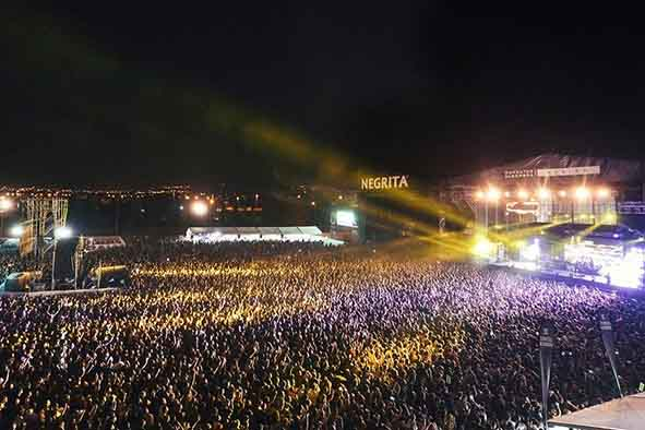 crowd in a concert cheering their favourite music band at the granada sound music festival, spain