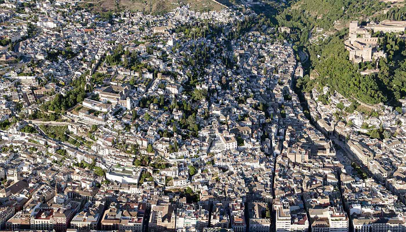 birds eye view of the albaicin and sacromonte quarter with the alhambra overlooking at them, spain