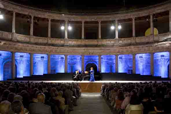 female singing on stage at Charles V palace during the international music festival of granada, in the añhambra
