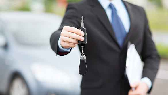 man handing out the car keys at the parking of the apartment for rent in granada, spain