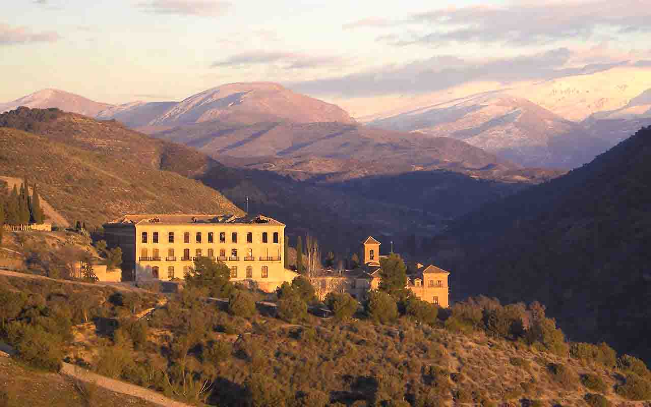 view of sacromonte abbey with snowy Sierra Nevada natural park in the back, spain