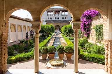 alhambra Generalife garden seen through muslim arches