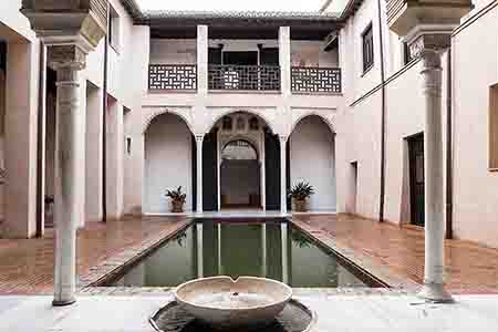 Arab house with fountain feed water to background pond, in the albayzin, granada
