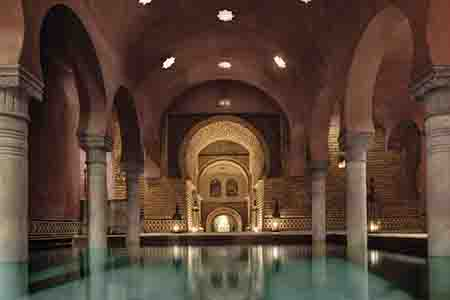 Arab hammam spa hot water pool with arches in granada, spain