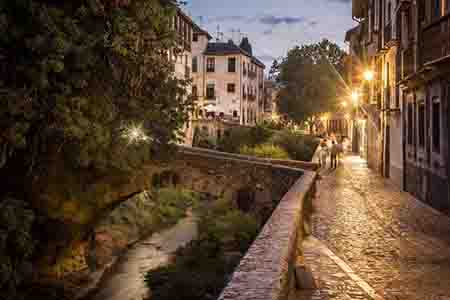 albaicin street along Darro River at sunset, in granada, just below the alhambra, spain