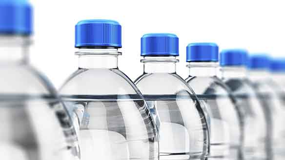 Row of plastic bottles on white background with selective focus effect
